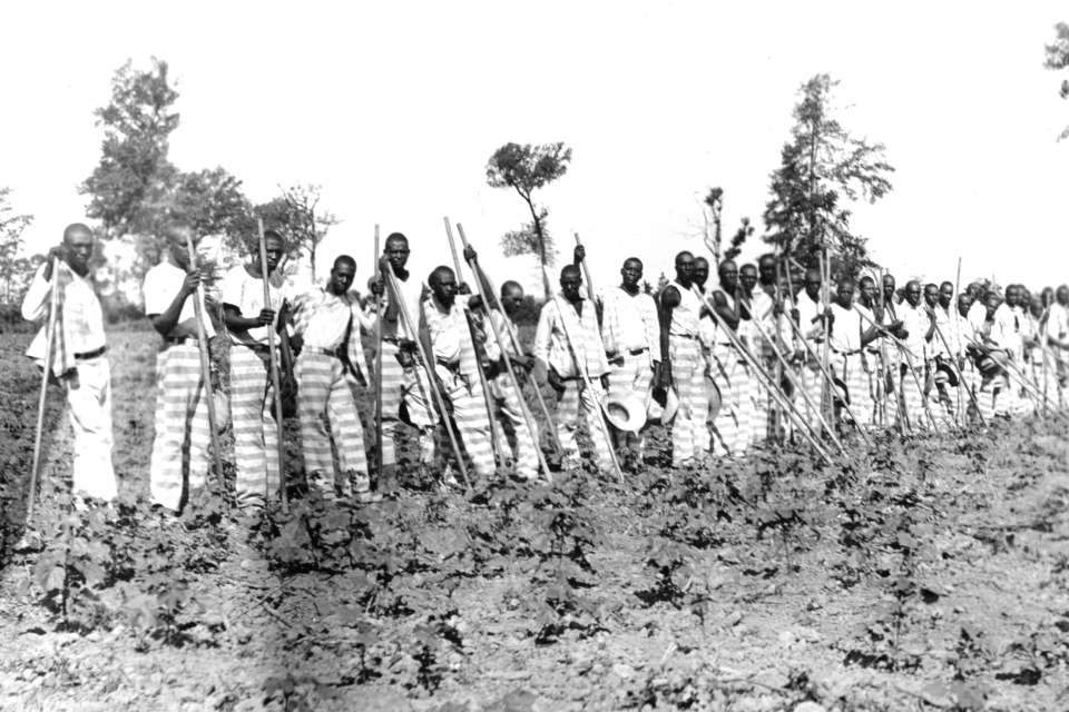 Parchman #13: Inmates line-up with their garden tools for a photo on Parchman Farm circa 1930.